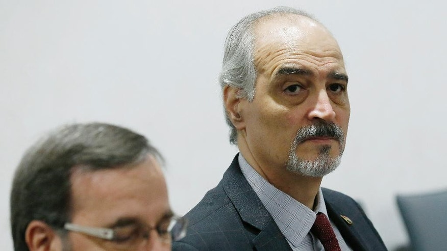 Syrian ambassador to the United Nations and Head of the government delegation Bashar al-Jaafari, right, attends a meeting next to Syrian ambassador to the U.N. Houssam-Eddin Ala during Syria peace talks at the United Nations in Geneva, Switzerland, Wednesday, April 20, 2016. (Denis Balibouse/Pool Photo via AP)
