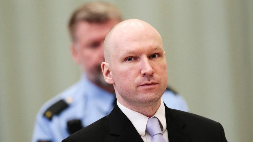 FILE - In this Friday, March 18, 2016 file photo, Anders Behring Breivik stands on the fourth and last day in court in Skien, Norway. The right-wing extremist was convicted of terrorism and mass murder for 2011 bomb and gun attacks in Norway that killed 77 people. (Lise Aserud/NTB Scanpix via AP, File)  NORWAY OUT
