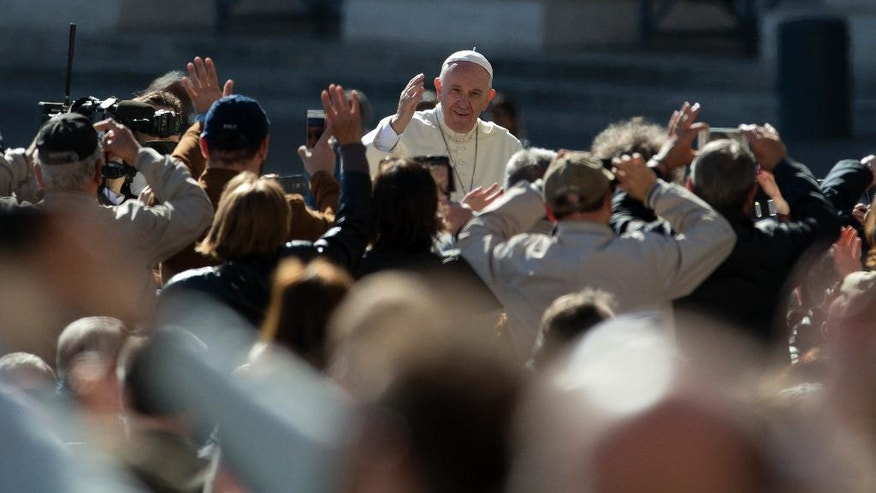 Pope Francis waves to the crowd as he arrives for his weekly general audience in St. Peter's Square, at the Vatican, Wednesday, April 20, 2016. (AP Photo/Andrew Medichini)