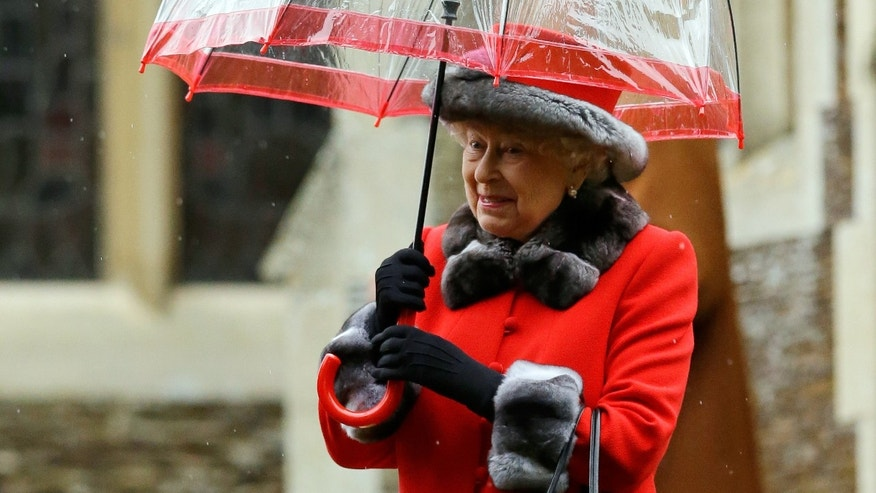 Britain's Queen Elizabeth II shelters under an umbrella as she leaves, after attending the British royal family's traditional Christmas Day church service at St. Mary Magdalene Church in Sandringham, England, Friday, Dec. 25, 2015.  (AP Photo/Matt Dunham)