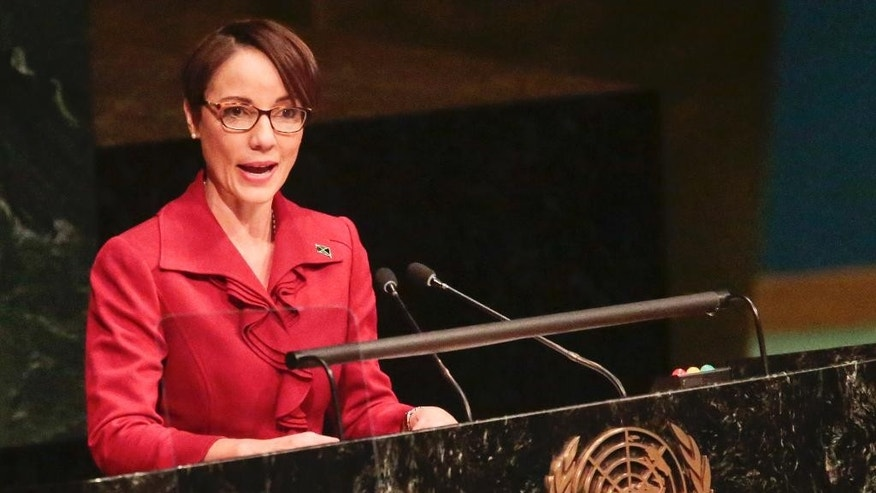 Jamaica's Minister for Foreign Affairs and Foreign Trade Kamina Johnson Smith addresses the United Nations special session on global drug policy, Wednesday April 20, 2016 at U.N. headquarters. (AP Photo/Bebeto Matthews)