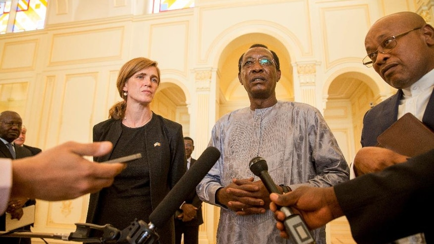 U.S. Ambassador to the United Nations Samantha Power, left, listens as Chad President Idriss Deby Itno, center, answers questions from members of the media through an interpreter at the presidential palace in N'Djamena, Chad, Wednesday, April 20, 2016. Power is traveling to Cameroon, Chad, and Nigeria to highlight the growing threat Boko Haram poses to the Lake Chad Basin region. (AP Photo/Andrew Harnik)