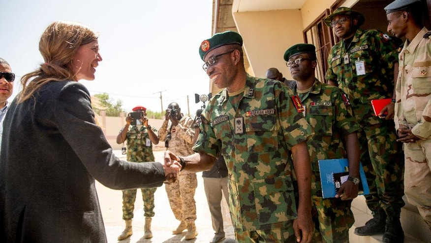 U.S. Ambassador to the United Nations Samantha Power, left, greets Multinational Joint Task Force Commander Maj. Gen. Lamidi Adeosun as she arrives at their headquarters in N'Djamena, Chad, Wednesday, April 20, 2016. Power is traveling to Cameroon, Chad, and Nigeria to highlight the growing threat Boko Haram poses to the Lake Chad Basin region. (AP Photo/Andrew Harnik)