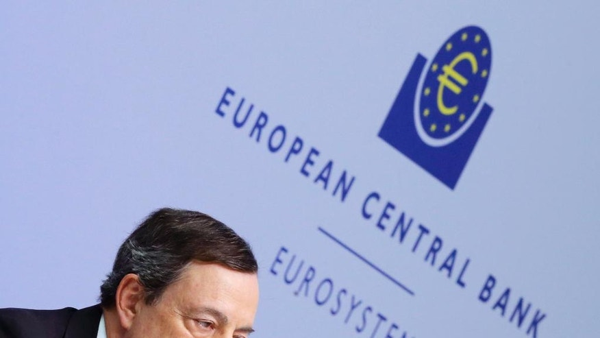 FILE - This Thursday, March 10, 2016 file photo shows, President of the European Central Bank, Mario Draghi, speaking during a press conference following a meeting of the governing council in Frankfurt, Germany. European Central Bank head Draghi is likely to underline Thursday, April 21, 2016, at his news conference, that monetary stimulus is working and that more is available if needed. (AP Photo/Michael Probst, File)