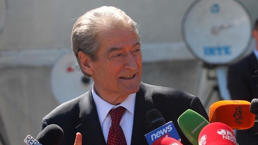 Former Albanian prime minister Sali Berisha speaks to the media outside Parliament in Tirana, Albania, Thursday April 21, 2016. Berisha, has called on Albanians to arm themselves because the government is failing to confront crime. Gun ownership is illegal in Albania and calls to break the law could result in a 10-year jail sentence. (AP Photo/Hektor Pustina)