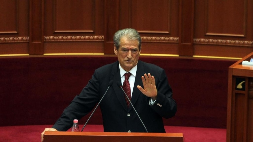 Former Albanian prime minister Sali Berisha speaks at Parliament in Tirana, Albania, Thursday April 21, 2016. Berisha, has called on Albanians to arm themselves because the government is failing to confront crime. Gun ownership is illegal in Albania and calls to break the law could result in a 10-year jail sentence. (AP Photo/Hektor Pustina)
