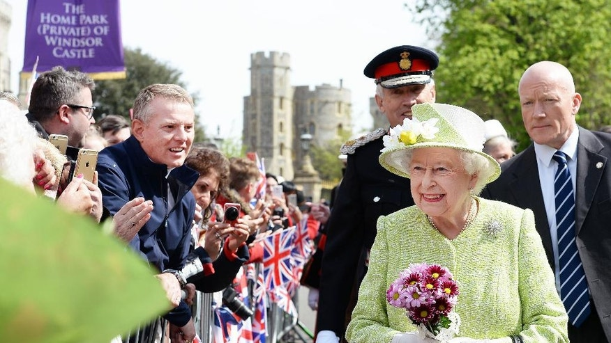 Queen Elizabeth II meets well wishers during a walkabout close to Windsor Castle as she celebrates her 90th birthday, in Berkshire, England, Thursday, April 21, 2016. (John Stillwell/Pool Photo via AP)