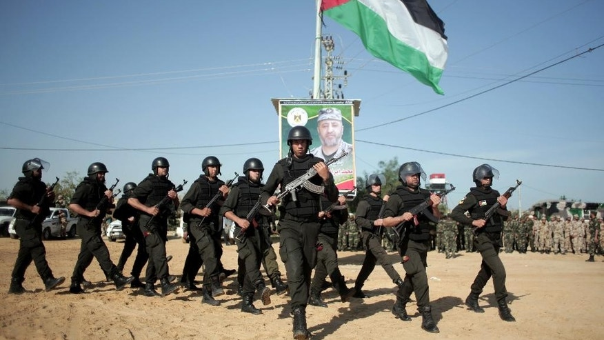 Palestinian Hamas security forces deploy on the Palestinian side of the border with Egypt in Rafah, southern Gaza Strip, Thursday, April 21, 2016. Hamas has deployed forces along the Egyptian-Gaza border to counter Cairo's concerns it is aiding militants from the Islamic State group in Egypt's lawless Sinai Peninsula. (AP Photo/ Khalil Hamra)