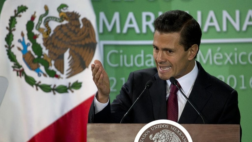 Mexican President Enrique Pena Nieto speaks during an announcement on marijuana policy, in Mexico City, Thursday April 21, 2016. Pena Nieto said Thursday he will ask Congress to raise the limit on decriminalized marijuana for personal use to 28 grams, or about one ounce. Mexico had previously exempted from prosecution only five grams, or less than a fifth of an ounce. The bill presented would free people who are on trial or serving time for possession of up to an ounce of marijuana. (AP Photo/Eduardo Verdugo)