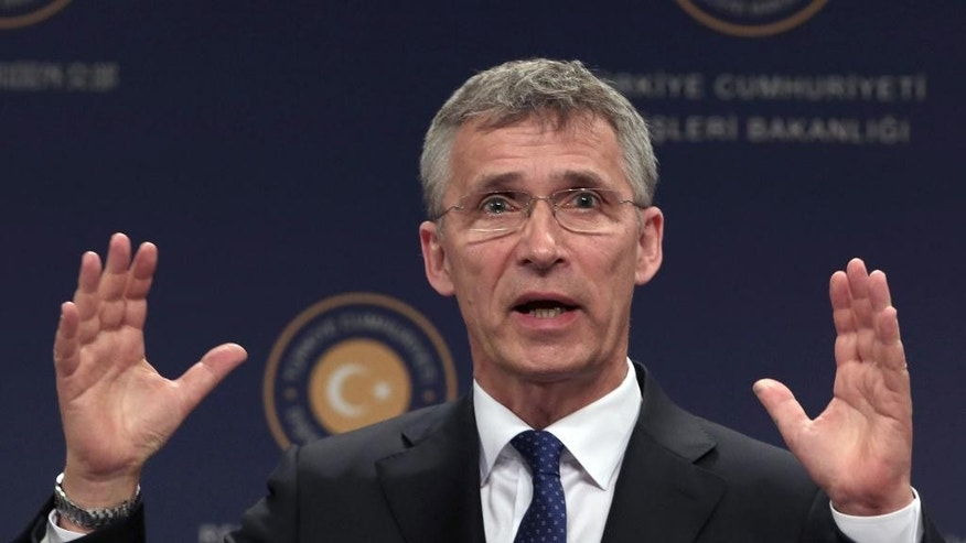 NATO Secretary General Jens Stoltenberg speaks to the media during a joint news conference with Turkish Foreign Minister Mevlut Cavusoglu in Ankara, Turkey, Thursday, April 21, 2016. Stoltenberg will be on media tour of NATO flagship Bonn on the Aegean Sea , which is part of the flotilla patrolling the Aegean in an effort to curb migrant activity. Stoltenberg says efforts to stem the tide of migrants seeking the shores of Europe are working.(AP Photo/Burhan Ozbilici)