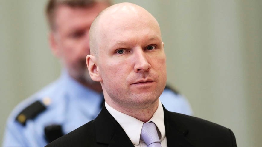 March 18, 2016: Anders Behring Breivik stands on the fourth and last day in court in Skien, Norway.