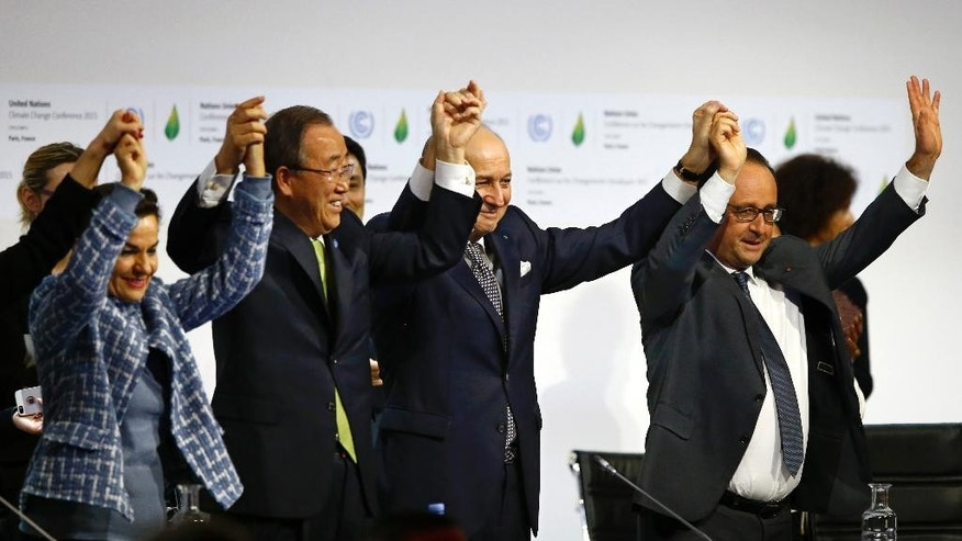 FILE - In this Dec. 12, 2015, file photo, French President Francois Hollande, right, French Foreign Minister and president of the COP21 Laurent Fabius, second right, United Nations climate chief Christiana Figueres, left, and United Nations Secretary General Ban Ki-moon hold their hands up in celebration after the final conference at the COP21, the United Nations conference on climate change, in Le Bourget, north of Paris. About 160 countries are expected to sign the Paris Agreement on climate change Friday, April 22, 2016, in a symbolic triumph for a landmark deal that once seemed unlikely but now appears on track to enter into force years ahead of schedule. The agreement, the world's response to hotter temperatures, rising seas and other impacts of climate change, was hammered out in December outside Paris. (AP Photo/Francois Mori, File)