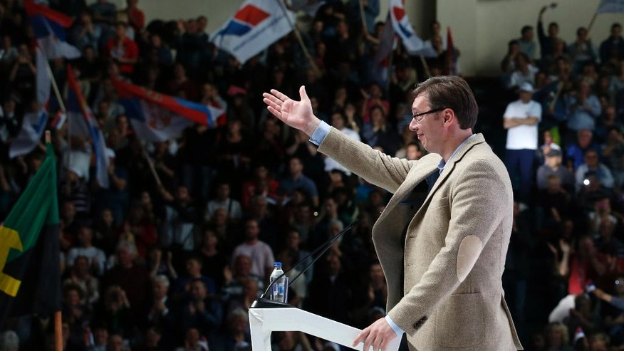 In this photo taken Thursday, April 14, 2016, Serbian Prime Minister Aleksandar Vucic speaks during a pre-election rally in Pozarevac, Serbia. A veteran politician who has transformed from radical anti-Western nationalist into a pro-EU reformer, Vucic has positioned himself as a dominant player both in Serbia and wider in the postwar Balkans. (AP Photo/Darko Vojinovic)