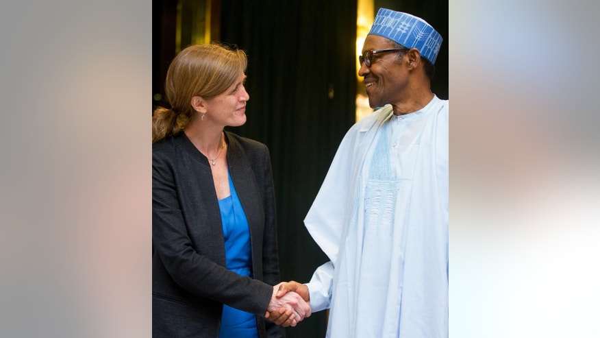 U.S. Ambassador to the United Nations Samantha Power, center left, shakes hands with Nigeria's President Muhammadu Buhari, center right, after meeting at the Presidential Villa in Abuja, Nigeria, Thursday, April 21, 2016. Power is traveling to Cameroon, Chad, and Nigeria to highlight the growing threat Boko Haram poses to the Lake Chad Basin region. (AP Photo/Andrew Harnik)
