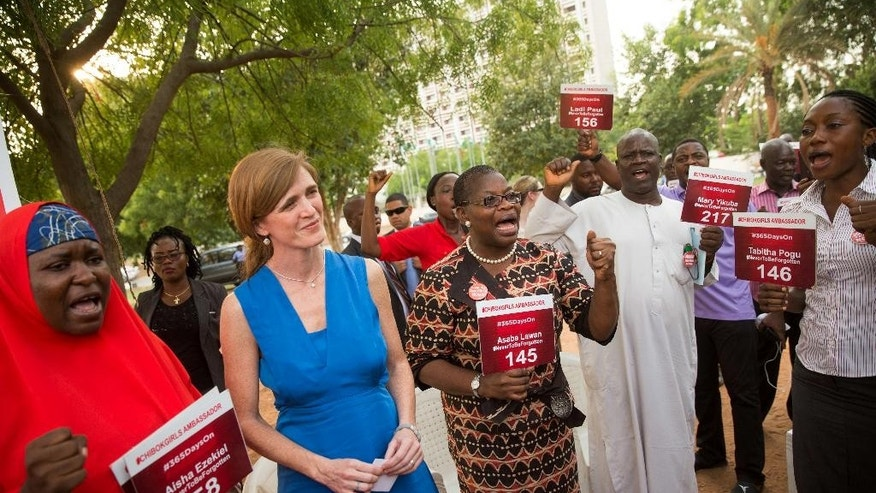 U.S. Ambassador to the United Nations Samantha Power, second from right, stands next to Bring Back Our Girls co-founder Obiageli Ezekwesili, center and Aisha Yesufu, left, as she attends a Bring Back Our Girls vigil in Abuja, Nigeria, Thursday, April 21, 2016, which, two years after Boko Haram abducted the girls from their school, is still held daily. A total of 219 girls remain missing, and Power said she couldn't imagine the frustration of the families. Power is traveling to Cameroon, Chad, and Nigeria to highlight the growing threat Boko Haram poses to the Lake Chad Basin region. (AP Photo/Andrew Harnik)