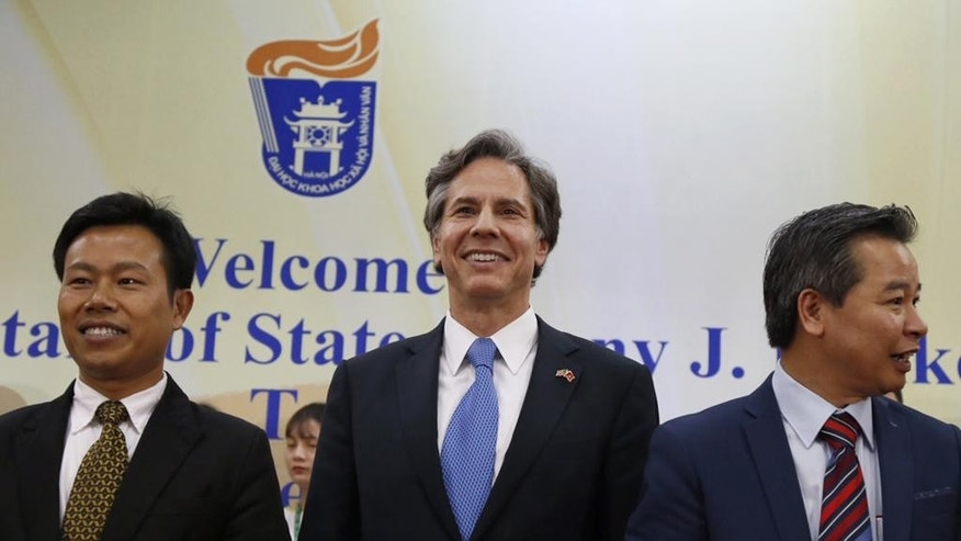 U.S. Deputy Secretary of State Antony Blinken, center, smiles with unidentified officials of Vietnam National University during his visit, in Hanoi, Vietnam, Thursday, April, 21, 2016. Blinken on Thursday questioned China's intentions with its massive land reclamation project in the South China Sea during his visit. China claims the entire South China sea, a water area believed to be rich in oil and gas and is one of the world's busiest maritime lines. The territorial claim is disputed by other countries in the region, including Vietnam and the Philippines. (AP Photo/Tran Van Minh)