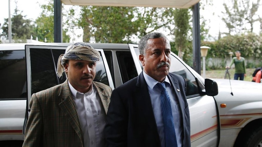 A head of the Houthis and allies team to Yemen peace talks in Kuwait, Arif Al-Zoka, right, arrives at Sanaa airport before the team leaves in Sanaa, Yemen, Wednesday, April 20, 2016. Yemen's Shiite rebels have reversed an earlier decision to boycott U.N.-sponsored peace talks designed to find a way to end the war in the impoverished Arab nation and their delegation was on its way Wednesday, heading to the negotiations, due to take place in Kuwait. (AP Photo/Hani Mohammed)