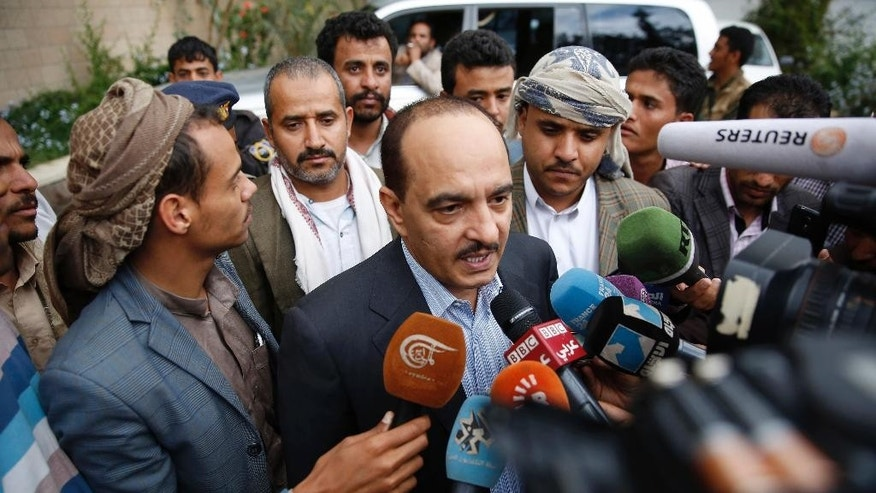 A member of the Houthis and allies team to Yemen peace talks in Kuwait, Yahya Douaid, talks to media at Sanaa airport before the team leaves in Sanaa, Yemen, Wednesday, April 20, 2016. Yemen's Shiite rebels have reversed an earlier decision to boycott U.N.-sponsored peace talks designed to find a way to end the war in the impoverished Arab nation and their delegation was on its way Wednesday, heading to the negotiations, due to take place in Kuwait. (AP Photo/Hani Mohammed)