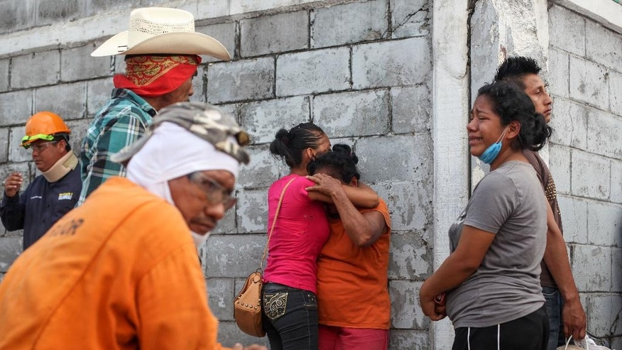 Relatives of missing workers gather outside the Pajaritos petrochemical complex in Coatzacoalcos, Mexico, Thursday, April,  21, 2016. At least 13 people are now confirmed dead and scores of others were injured in the Wednesday afternoon explosion inside the plant. The state oil company Petroleos Mexicanos, or Pemex, said the plant, operated by Mexichem, in partnership with Pemex, produces vinyl chloride, a hazardous industrial chemical. (AP Photo/Felix Marquez)