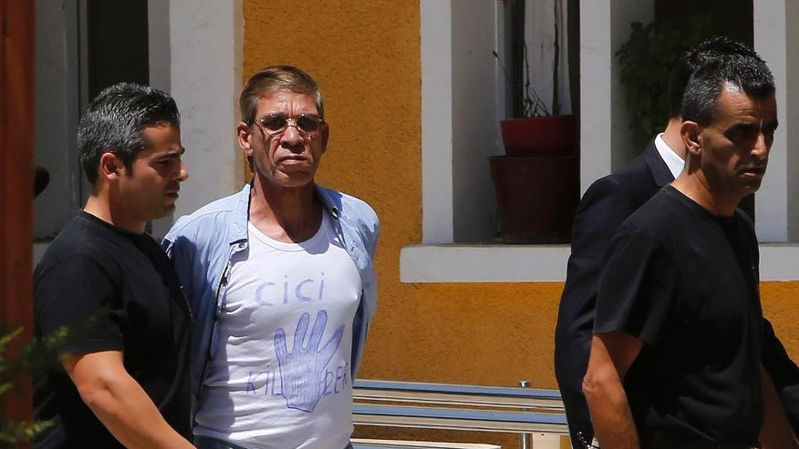 "EgyptAir plane hijack suspect Seif Eddin Mustafa, 59, 2nd left,  with t-shirt  is escorted by Cyprus police officers as he arrives in a court in capital Nicosia, Cyprus, Friday, April 22, 2016. Mustafa described as ""psychologically unstable"" hijacked a flight on  Tuesday, March 29, 2016, from Egypt to Cyprus and threatened to blow it up. His explosives turned out to be fake, and he surrendered with all passengers released unharmed after a bizarre six-hour standoff. (AP Photo/Petros Karadjias)"