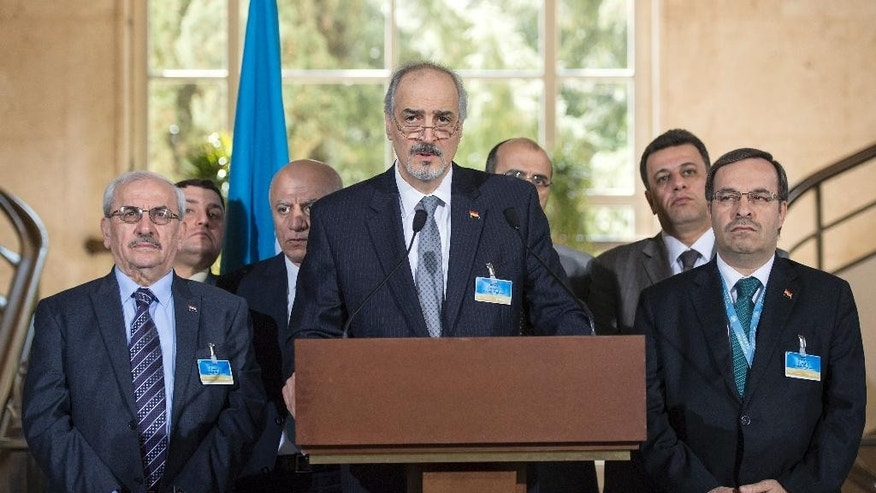 Syrian chief negotiator Bashar al-Jaafari, Ambassador of the Permanent Representative Mission of Syria to the United Nations, center, speaks during a press conference after a round of negotiations between the Syrian government and UN Special Envoy for Syria Staffan de Mistura, in Geneva, Switzerland, Friday, April 22, 2016. (Martial Trezzini/Keystone via AP)
