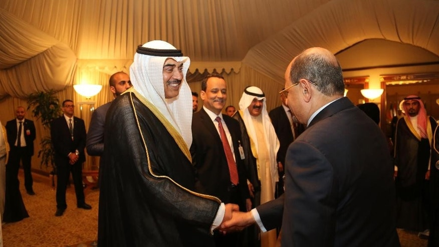 This Thursday, April 21, 2016 photo released by KUNA, Kuwait's state news agency shows Acting Prime Minister and Foreign Minister Sheikh Sabah Khaled Al-Hamad Al-Sabah, center,  at Yemen talks in Kuwait City. The talks are between Yemen's internationally-recognized government, which is backed by a Saudi-led military coalition, and Shiite rebels known Houthis and their allies, who hold the capital, Sanaa.(Amiri Diwan, KUNA via AP)