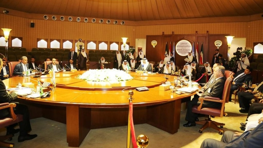 This Thursday, April 21, 2016 photo released by KUNA, Kuwait's state news agency shows delegates meeting in Kuwait City from Yemen's internationally-recognized government, which is backed by a Saudi-led military coalition, and Shiite rebels known Houthis and their allies, who hold the capital, Sanaa.(Amiri Diwan, KUNA via AP)