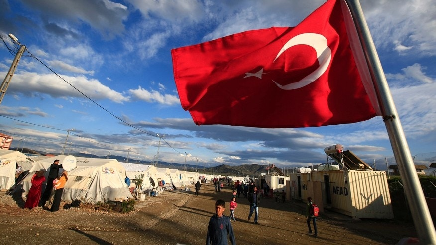 March 16, 2016: A Turkish flag flies at the refugee camp for Syrian refugees in Islahiye, Gaziantep province, southeastern Turkey.