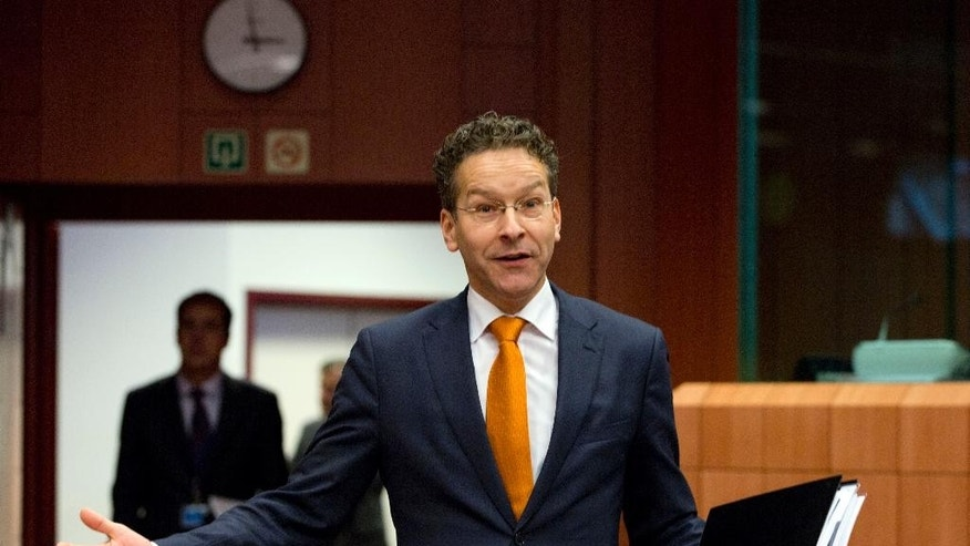 FILE - In this Thursday, Jan. 14, 2016 file photo, Dutch Finance Minister Jeroen Dijsselbloem gestures as he arrives for a meeting of eurogroup finance ministers at the EU Council building in Brussels. Greece's creditors said Friday, April 22, 2016 they are within touching distance of an agreement over the next batch of reforms the cash-strapped country has to make to unlock further bailout funds and trigger debt-relief discussions. Following weeks of criticism and delay, Jeroen Dijsselbloem, the top official of the grouping of the 19 euro countries, said a decisive breakthrough could come as soon as next Thursday, when a special meeting of the eurogroup will likely be held in Brussels. (AP Photo/Virginia Mayo, file)