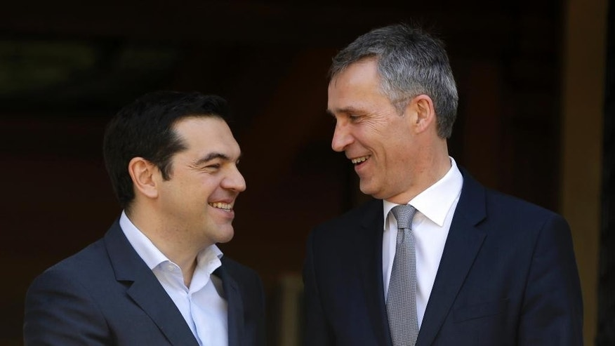Greece's Prime Minister Alexis Tsipras, left, welcomes NATO Secretary-General Jens Stoltenberg before their meeting at Maximos Mansion in Athens, Friday, April 22, 2016. Efforts to stem the tide of migrants seeking the shores of Europe are working, Stoltenberg said Thursday. (AP Photo/Thanassis Stavrakis)