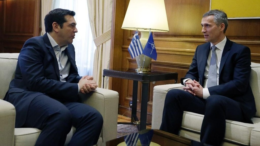 Greece's Prime Minister Alexis Tsipras, left, speaks with NATO Secretary-General Jens Stoltenberg during their meeting at Maximos Mansion in Athens, Friday, April 22, 2016. Efforts to stem the tide of migrants seeking the shores of Europe are working, Stoltenberg said Thursday. (AP Photo/Thanassis Stavrakis)