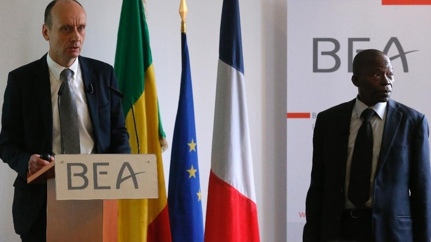 Remi Jouty, the head of France's Bureau of Investigation and Analysis for the Security of Civil Aviation (BEA) left, flanked with Mali's counterpart N'Faly Cisse delivers his speech on 2014 Air Algerie crash over Mali, blaming a mixture of mistakes for the disaster which killed 116 people, during a press conference in Le Bourget, north of Paris, France, Friday, April 22, 2016. Jouty says that the McDonnell Douglas MD-83 went down on July 24, 2014 near the rural town of Gossi after problems with its sensors probably caused by obstruction by ice crystals. (AP Photo/Francois Mori)
