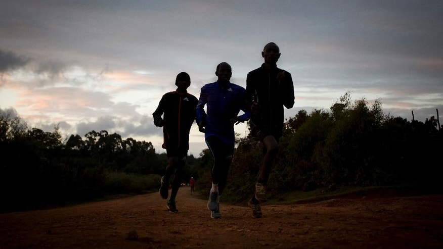FILE - In this Saturday, Jan. 30, 2016 file photo, Kenyan athletes train just after dawn, in Kaptagat Forest in western Kenya. Kenya's sports minister said Tuesday, April 19, 2016 that a long-awaited anti-doping law has been passed by the country's parliament and now only needs to be signed by the president - legislation that must be in place by May 2 to beat a final deadline set by the World Anti-Doping Agency. (AP Photo/Ben Curtis, File)