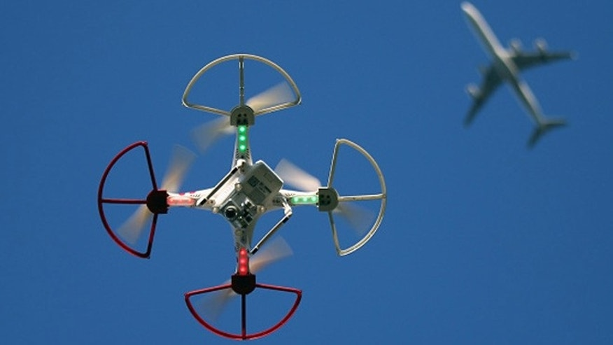 OLD BETHPAGE, NY - SEPTEMBER 05:  A drone is flown for recreational purposes as an airplane passes nearby in the sky above Old Bethpage, New York on September 5, 2015.  (Photo by Bruce Bennett/Getty Images)
