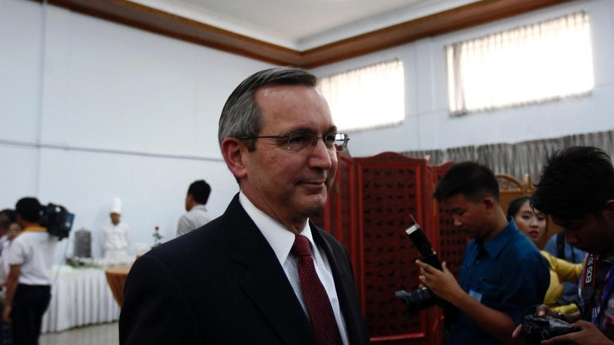 Scot Marcie, U.S Ambassador to Myanmar, attends a meeting with Myanmar Foreign Affair Minister Aung San Suu Kyi at the Ministry of Foreign Affairs, Friday, April 22, 2016, in Naypyitaw, Myanmar. Aung San Suu Kyi met Friday with foreign diplomats at her Foreign Ministry. (AP Photo/Aung Shine Oo)