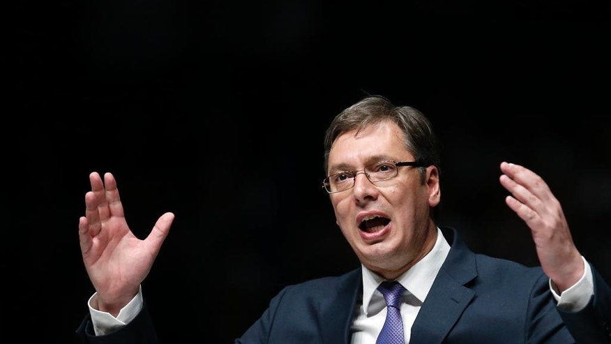 In this Thursday, April 21, 2016 photo, Serbian Prime Minister Aleksandar Vucic speaks during a pre-election rally in Novi Sad, Serbia. Serbs vote in a snap election on Sunday that will test Vucic's proclaimed bid to lead the Balkan nation toward the European Union. Vucic and his Progressive Party are expected to win most votes, but far-right groups favoring close ties with Russia over EU bid have also surged. Radical Party leader Vojislav Seselj is slated to return to Parliament after being recently acquitted of war crimes by a U.N. tribunal. (AP Photo/Darko Vojinovic)
