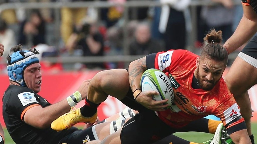 Derek Carpenter, right, of Japan's Sunwolves is tackled by Matias Alemanno of Argentina's Jaguares during their Super Rugby match in Tokyo, Saturday, April 23, 2016. The Sunwolves won 36-28. (AP Photo/Koji Sasahara)