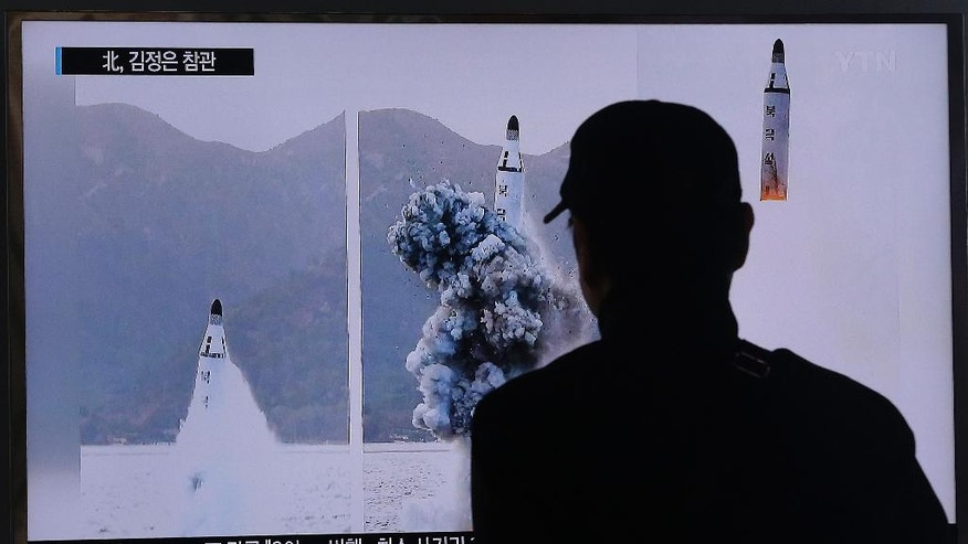"A South Korean man watches a TV news program showing images published Sunday in North Korea's Rodong Sinmun newspaper of North Korea's ballistic missile that the North claimed to have launched from underwater, at Seoul Railway station in Seoul, South Korea, Sunday, April 24, 2016. North Korea said Sunday that it successfully test-fired a ballistic missile from a submarine and warned of its growing ability to cut down its enemies with a ""dagger of destruction."" South Korea couldn't immediately confirm the claim of success in what marks Pyongyang's latest effort to expand its military might in face of pressure by its neighbors and Washington. (AP Photo/Ahn Young-joon)"