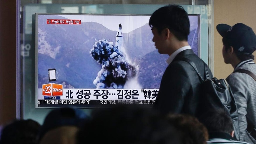 "People walk by a TV news program showing an image published Sunday in North Korea's Rodong Sinmun newspaper of North Korea's ballistic missile that the North claimed to have launched from underwater, at Seoul Railway station in Seoul, South Korea, Sunday, April 24, 2016. North Korea said Sunday that it successfully test-fired a ballistic missile from a submarine and warned of its growing ability to cut down its enemies with a ""dagger of destruction."" South Korea couldn't immediately confirm the claim of success in what marks Pyongyang's latest effort to expand its military might in face of pressure by its neighbors and Washington. The letters on the screen read: ""North Korea said it successfully test-fired a ballistic missile."" (AP Photo/Ahn Young-joon)"