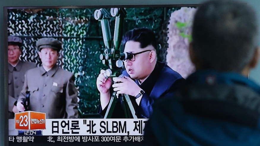 "A South Korean man watches a TV news program showing an image published Sunday in North Korea's Rodong Sinmun newspaper of North Korean leader Kim Jong Un at Seoul Railway station in Seoul, South Korea, Sunday, April 24, 2016. North Korea said Sunday that it successfully test-fired a ballistic missile from a submarine and warned of its growing ability to cut down its enemies with a ""dagger of destruction."" South Korea couldn't immediately confirm the claim of success in what marks Pyongyang's latest effort to expand its military might in face of pressure by its neighbors and Washington. The letter on the screen read: ""Japanese media says North Korea fired a SLBM, submarine-launched ballistic missile, against sanction."" (AP Photo/Ahn Young-joon)"