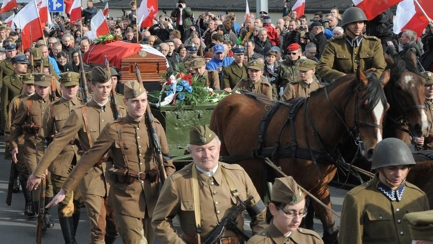 The coffin with the remains of Zygmunt Szendzielarz is driven on a horse carriage during his funeral in Warsaw, Poland, Sunday, April 24, 2016. Polish President Andrzej Duda and government ministers have taken part in the state burial of Szendzielarz, a World War II resistance commander and communist regime victim whose remains were found in a hidden mass grave. (AP Photo/Alik Keplicz)