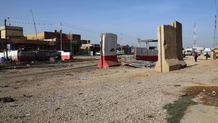 The damaged checkpoint in seen in aftermath of a suicide car bomb in the eastern suburb of Hussainiyah, Baghdad, Iraq, Sunday, April 24, 2016. Suicide attacks targeting security forces in two Baghdad suburbs have killed and wounded dozens of people on late Saturday officials said. (AP Photo/Karim Kadim)