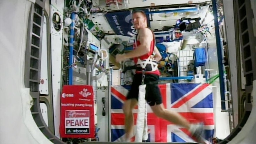 British astronaut Tim Peake in action running the London marathon while strapped to a treadmill to counter the lack of gravity at the International Space Station on Sunday April 24, 2016. While the official 2016 London Marathon was being run in London, Peake ran 26.2 miles on a treadmill in three hours 35 minutes 21 seconds, while aboard the space station in orbit 250km above the Earth.(EUROPEAN SPACE AGENCY (ESA) via AP) TV OUT