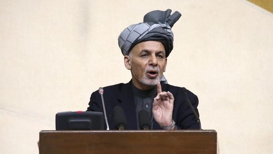In this photo released by Afghanistan's Presidential Palace, President Ashraf Ghani speaks during a joint meeting of the National Assembly in Kabul, Afghanistan, Monday, April 25, 2016. Ghani has called on Pakistan to battle the Taliban rather than try to bring them into peace talks. He made the remarks during an address to parliament a week after a Taliban assault on the capital that killed 64 people and wounded another 340. (Afghan Presidential Palace via AP)