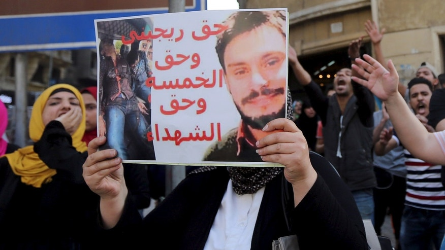 April 15, 2016: An Egyptian activist holds a poster calling for justice to be done in the case of the recently murdered Italian student Giulio Regeni during a demonstration protesting the government's decision to transfer two Red Sea islands to Saudi Arabia, in front of the Press Syndicate in Cairo, Egypt. (Reuters)