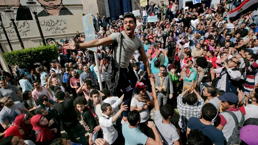 April 15, 2016: Egyptians shout slogans against Egyptian President Abdel-Fattah el-Sisi during a protest against the decision to hand over control of two strategic Red Sea islands to Saudi Arabia in front of the Press Syndicate, in Cairo, Egypt. Egyptian security forces have rounded up dozens of activists, journalists, and lawyers ahead of demonstrations called for April 25.