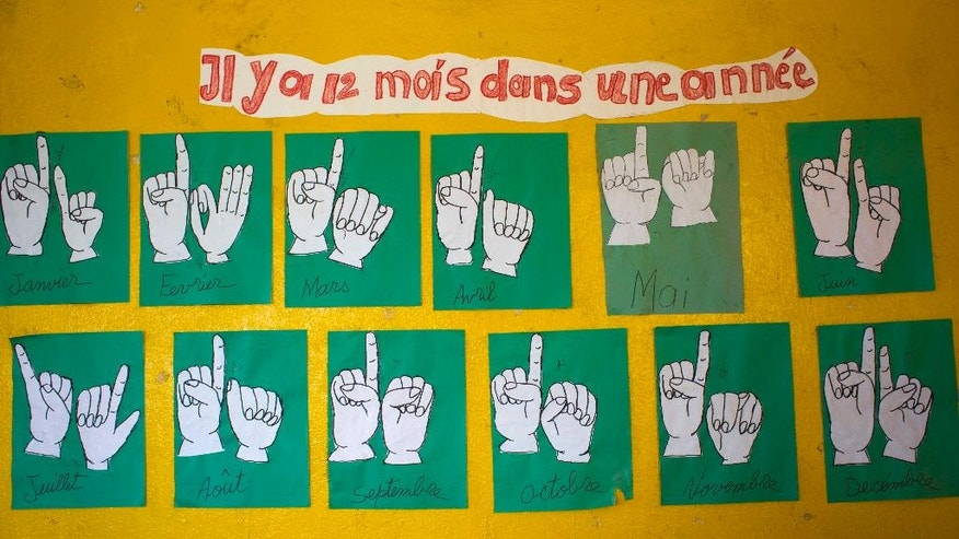 April 17, 2016: The names of the months in French and sign language inside a classroom for deaf students in Leveque.