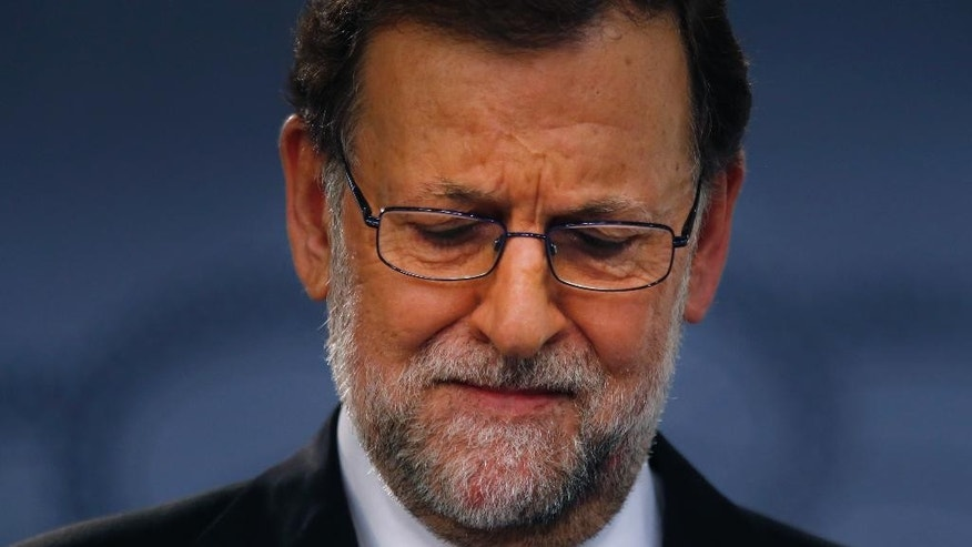 FILE - In this Friday, Jan. 22, 2016 file photo, Spain's Prime Minister Mariano Rajoy looks down as he talks to journalists during a news conference at the Moncloa Palace following his meeting with Spain's King Felipe VI, in Madrid. Spain's king is meeting Monday and Tuesday with the country's political parties following four months of political paralysis in a last-ditch effort to install a government and avoid sending voters back to the ballot box. (AP Photo/Francisco Seco, File)