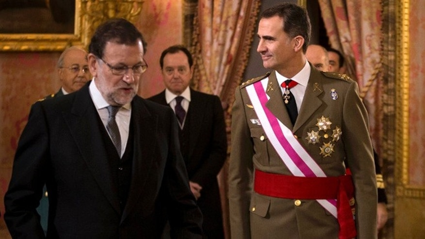 FILE - In this Wednesday, Jan. 6, 2016 file photo, Spain's King Felipe VI walks with Spain's Prime Minister Mariano Rajoy, left, during the annual Pascua Militar Epiphany ceremony at the Royal Palace in Madrid, Spain. Spain's king is meeting Monday and Tuesday with the country's political parties following four months of political paralysis in a last-ditch effort to install a government and avoid sending voters back to the ballot box. (AP Photo/Daniel Ochoa de Olza, File)