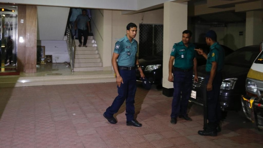 Bangladeshi policemen arrive at a building where two people were found stabbed to death in Dhaka, Bangladesh, Monday, April 25, 2016. Police in Bangladesh say unidentified assailants have stabbed two men to death, including a gay rights activist who also worked for the U.S. Agency for International Development.(AP Photo/A.M.Ahad)